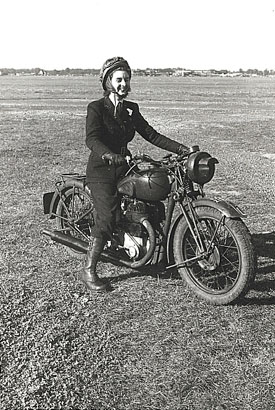 Female despatch rider wearing Air Transport Auxiliary uniform.