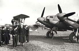 Sir Stafford Cripps visits White Waltham Airfield, Head Quarters of Air Transport Auxiliary. Behind on the left is Pauline Gower.