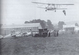 Whitchurch with Handley Page HP42 aircraft making its final approach to land.  Probably the only thing in common with today's aviation is that pilots still rely on a wind sleeve to determine the wind speed and direction.