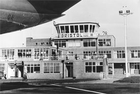 The terminal and air traffic control tower taken from beneath the tail of a Cambrian BAC1-11, 1968.