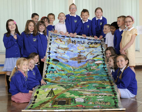 Pupils at New Oak Primary with their collage.