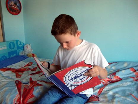 Jacob Cook, aged 8, reading the book.