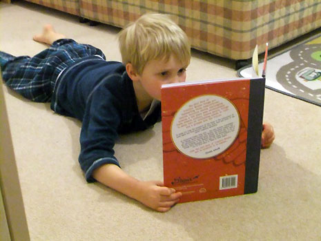 Wendy Massey has sent us pictures of her five year-old son reading the book which he obtained from his local library.