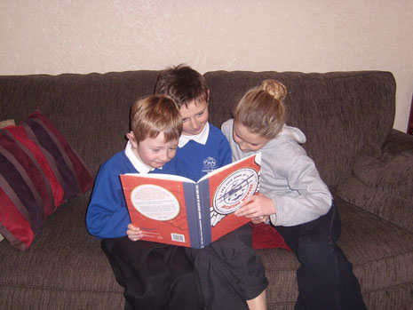 The McKelvie-Warsop family from Filton enjoying the book.