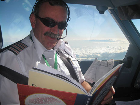 Here's Bob himself reading the book in the cockpit with Mount Kenya in the background.