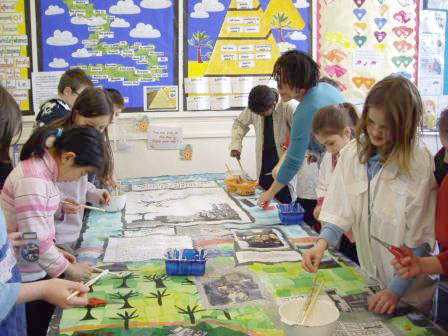 Pupils making a large-scale collage with artist Gloria Ojulari Sule.