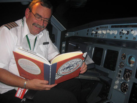 Bob checking his knowledge at 35,000 feet.