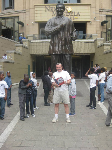Bob with the statue of Nelson Mandela in Johannesburg.